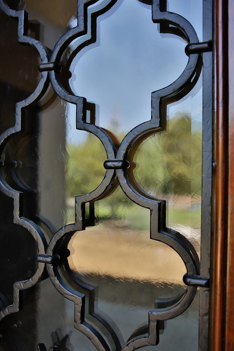 Piedmont Mediterranean Revival Wrought Iron Detail on Door Buestad Construction